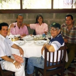 In Havana, with Spanish journalist (TVE) José Manuel Martín Medem. Seated at right, Cuban writers Angel Santiesteban (background) and Luis Adrián Betancourt. Havana, Cuba, 2004.